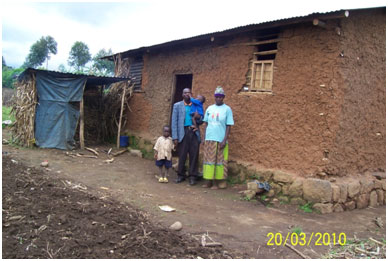 Pastor Emmanuel and his family outside of his house